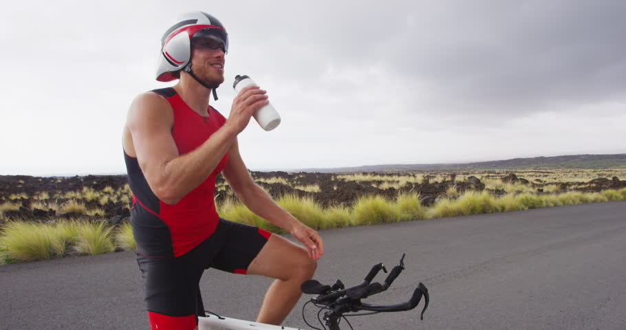 aef23e4a7bfe5 Man triathlete resting during training in full professional triathlon  cycling gear and clothing.