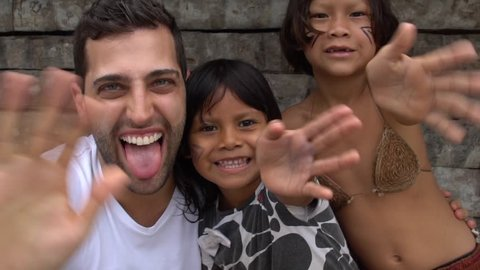 Tourist Having Fun with Indigenous Community - Tupi Guarani Tribe - in Brazil