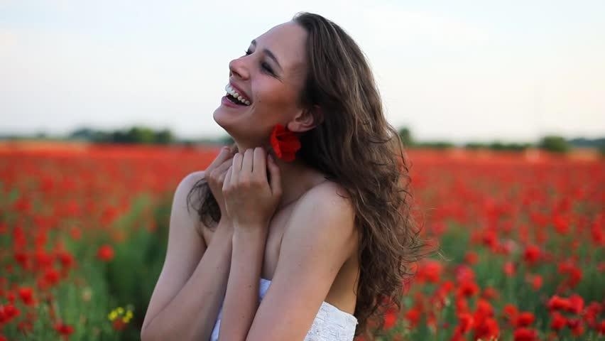 Beautiful young bride on poppy flower field