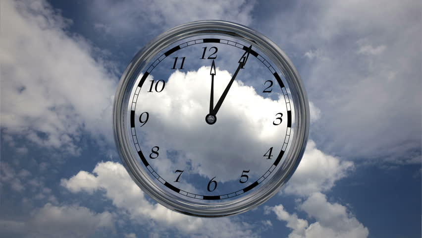 Time lapse, Time runs fast, clock running twelve hours on sky background with clouds.
