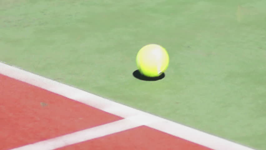 Missing the target concept,tennis ball bouncing out the court slow motion