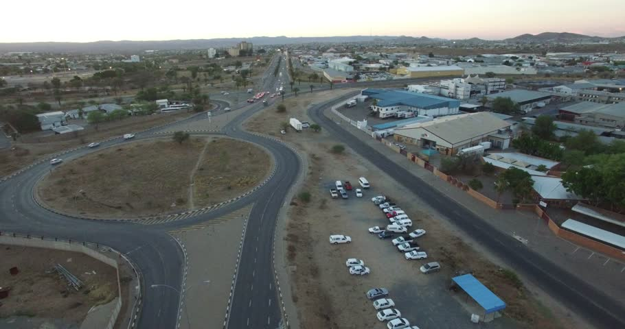 Aerial drone video with view of northern industrial area, highway in Windhoek to northern part of town in central highland Khomas Hochland of Namibia, southern Africa