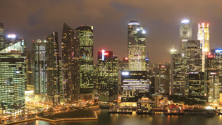 Time Lapse Singapore Skyline at Night.  View to Financial / Business District, Singapore River, Clarke Quay. Pan movement.