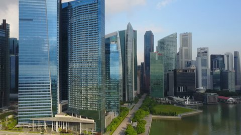 4k aerial footage of Singapore skyscrapers with City Skyline during cloudy summer day