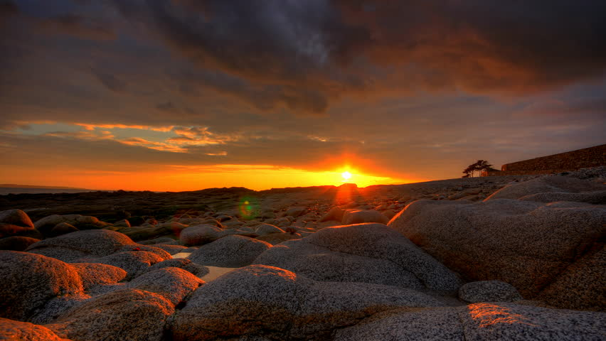Sunset over beach and rocks, 4K motion time lapse clip, High Dynamic Range Imaging