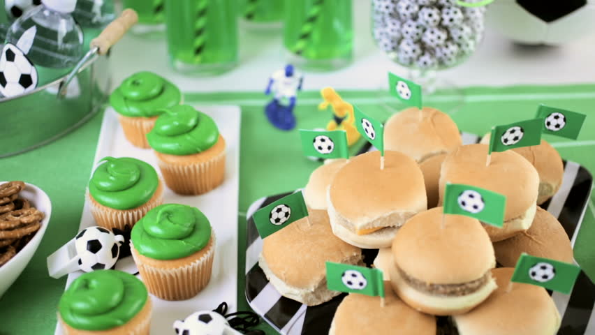 Kids football party set with snacks and drinks.
