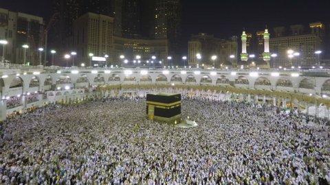Mecca, Saudi Arabia - September 15, 2016: Time lapse video of Muslim pilgrims circling around the holy Kaaba at night during Hajj inside al Masjid al Haram in Mecca, Saudi Arabia. Camera zoomin in.