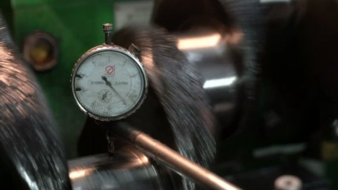 Crankshaft grinding. Micrometer with dial indicator. Engine overhaul.