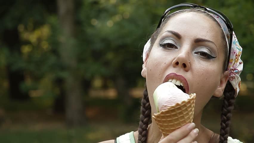 Woman eats ice-cream