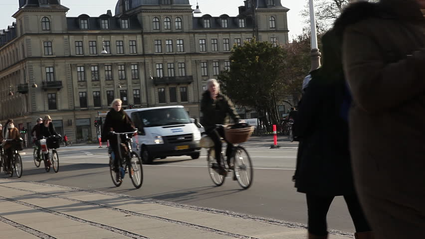 COPENHAGEN, DK - CIRCA 2011 -  Pedestrians and bicycle riders cruise down the street
