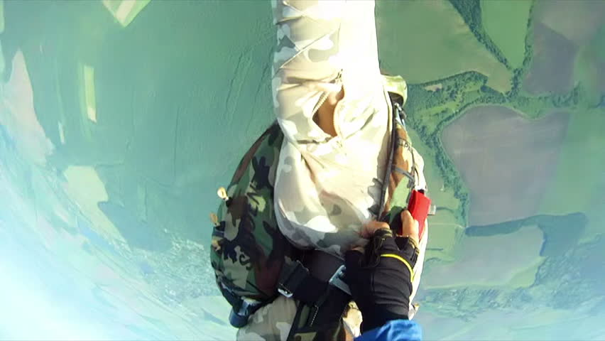 People skydive
