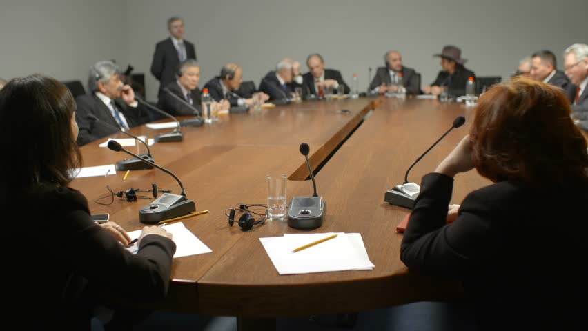 Public speaking at the round table during international negotiations