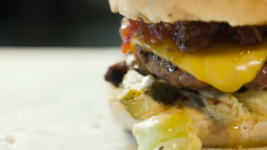 cheeseburger macro with kitchen background, tasty burger close up