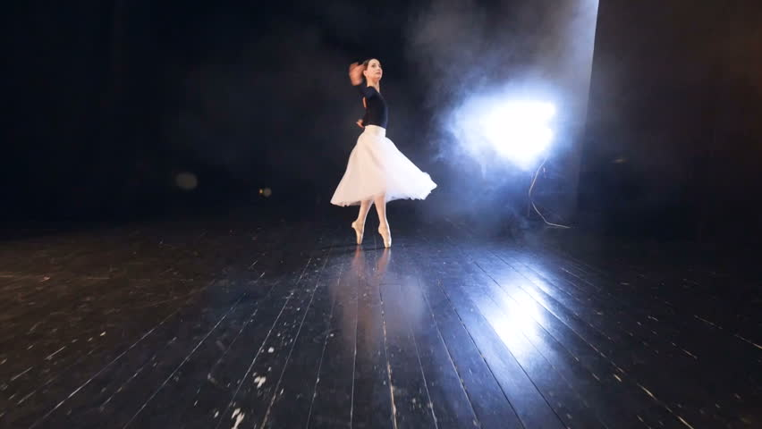 Close-up of the ballerina floating over the stage. Steadicam. HD. #26509964