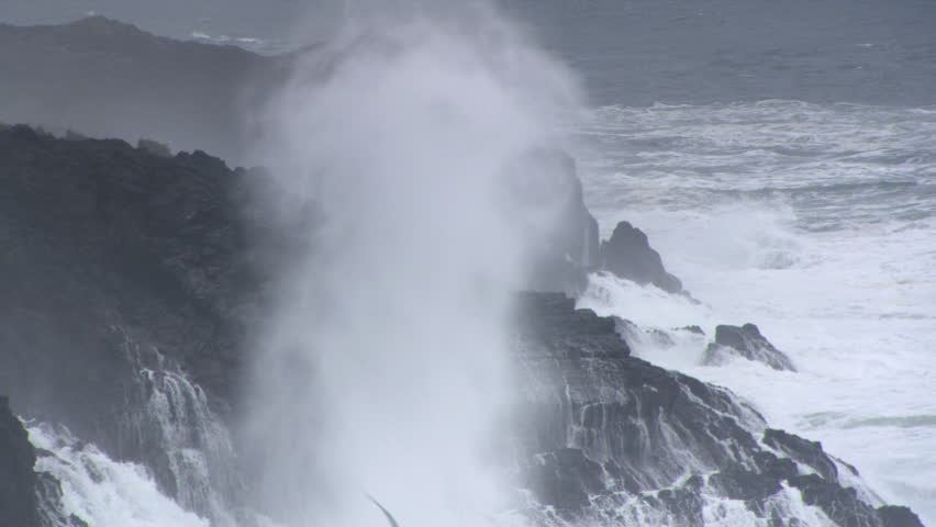 Spray from crashing waves drifting over high rocky outcrops | Shutterstock HD Video #26629069