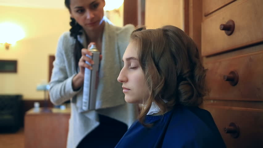 A hairdresser puts her hair through a hair dryer with a girl with short hair. Hairstyle retro #26632264