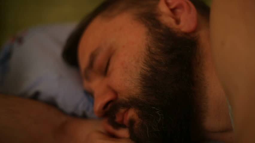 Man lying in the bed and has a really deep sleep