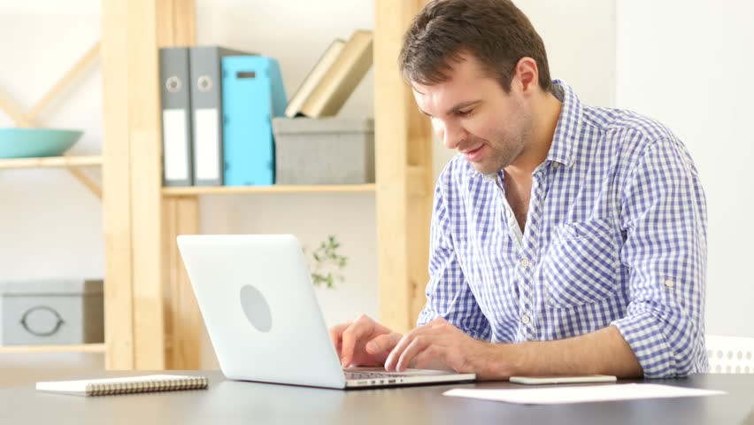 Excited Man Celebrating Success at Work | Shutterstock HD Video #26648464