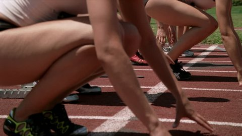 Slow-motion close-up of women runners before a race