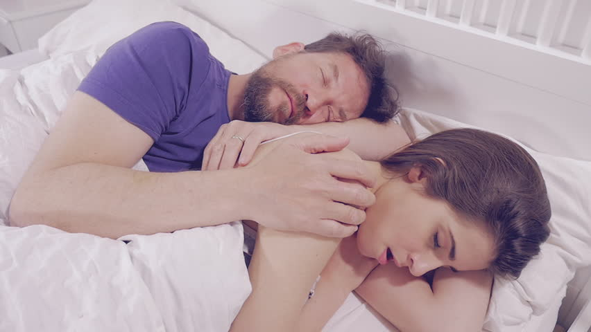 Woman In Bed Crying The Morning Sad Hugged By Sleeping Boyfriend