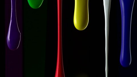 Paint dripping on black background shooting with high speed camera.