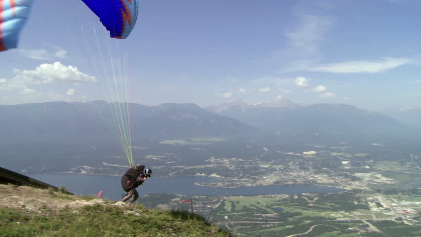 Paragliding high above the Columbia Valley at Invermere, British Columbia, Canada