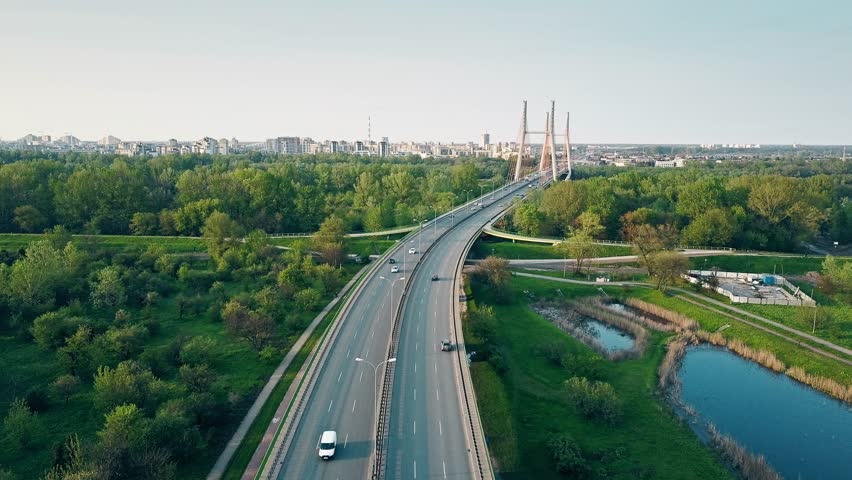 Aerial shot of highway and guyed car bridge in Warsaw. 4K clip