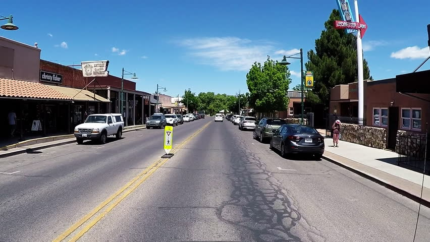 COTTONWOOD, AZ/USA: April 20, 2017- Driving shot through Old Town business district in Cottonwood Arizona. Clip reveals a view from a moving vehicle of the city street and small businesses downtown.