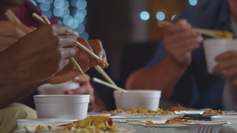 Adult friends sharing a Chinese take-away, close up mid section, shot on R3D