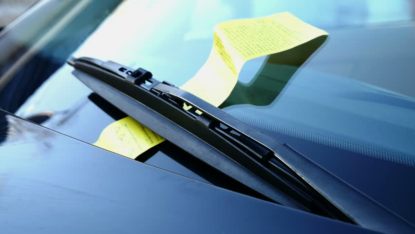 windshield and wipers with parking ticket
