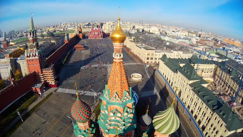 Saint Basil's Cathedral church in the Red Square museum UNESCO Moscow Russia  Pokrovsky. Central red square. Tourists walk. Decor of facades  Colored domes old architecture. Summer blue. Aerial above - HD stock video clip