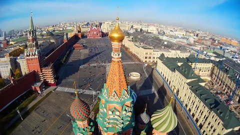 Saint Basil's Cathedral church in the Red Square museum UNESCO Moscow Russia  Pokrovsky. Central red square. Tourists walk. Decor of facades  Colored domes old architecture. Summer blue. Aerial above