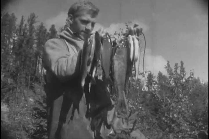 1950s Men And Women Fish For Artic Grayling Pose With Their Catches In