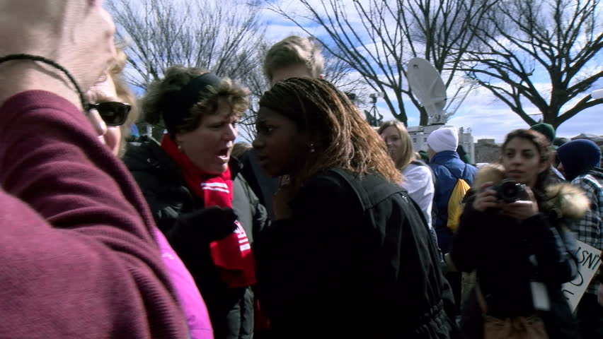 two women of opposing views hug at the March for Life rally in Washington, DC Jan. 27, 2017.