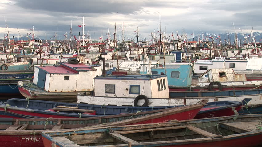 Many ships at a seaport in Puerto Natales, Chile