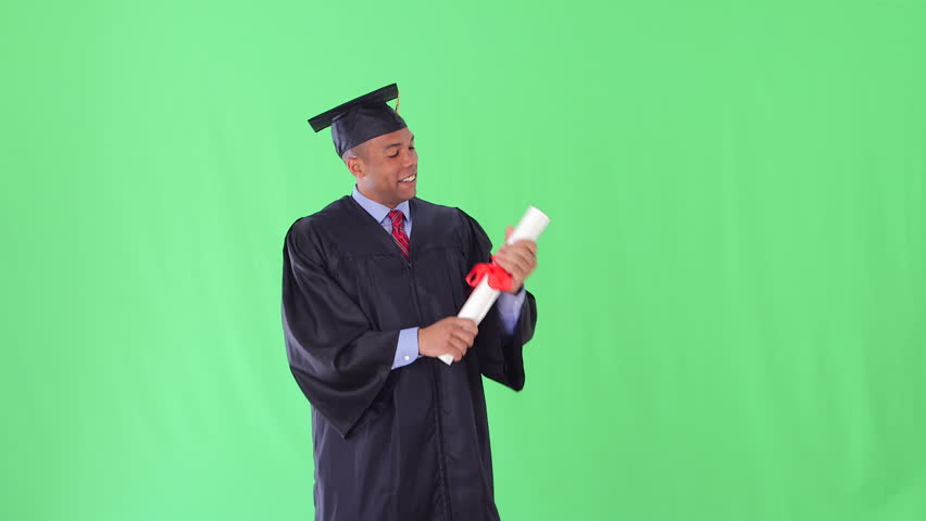 Stock Video Clip of African American man with graduation gown ...