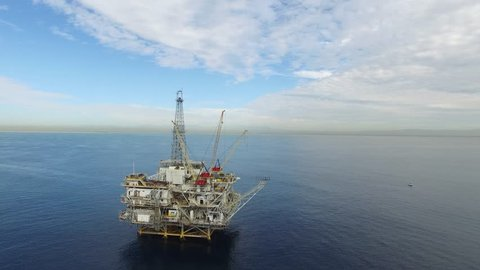 Aerial shot over an oil rig off the coast of Long Beach, California.