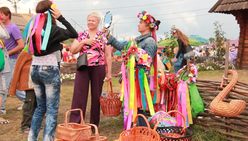 VELYKI SOROCHYNTSI, UKRAINE - AUGUST 17: People shop at the Sorochyntsy Fair on August 17, 2012 in Velyki Sorochyntsi, Ukraine. This large fair has been held every year since the end of Soviet rule and was declared Ukraine's national trade fair in 1999.