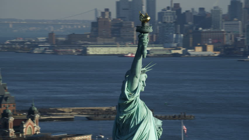 Close orbit of the upper portion of the Statue of Liberty, Jersey City in background. Shot in 2011. | Shutterstock HD Video #26876800