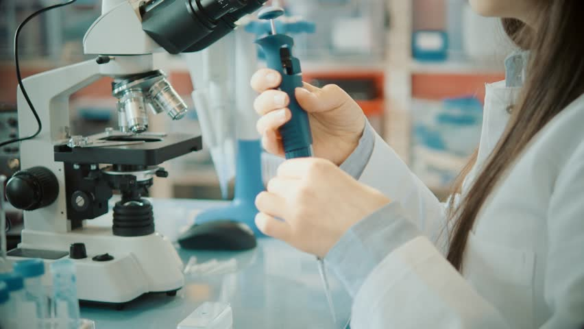 Young woman in microbiological lab #26883454