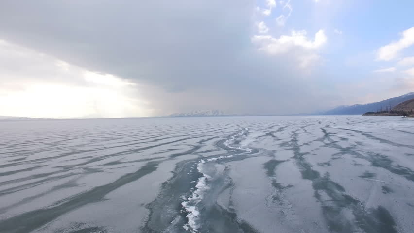 4K Flying over iced sea or ocean by helicopter .