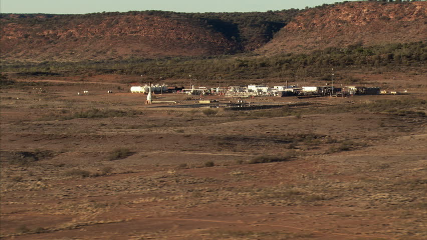 Zoom-out on an oil refinery in the Australian Outback near Alice Springs