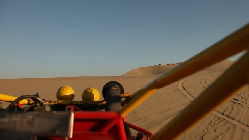 video footage of driving with a buggy off-road in the dunes of Ica, Peru