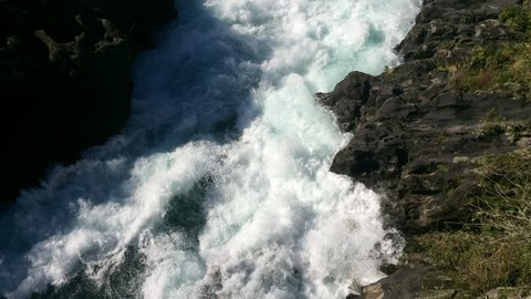 Aratiatia Rapids on the Waikato River after the spill gates of the hydroelectric dam at the top of the narrow gorge have been opened near Taupo in the North Island of New Zealand.