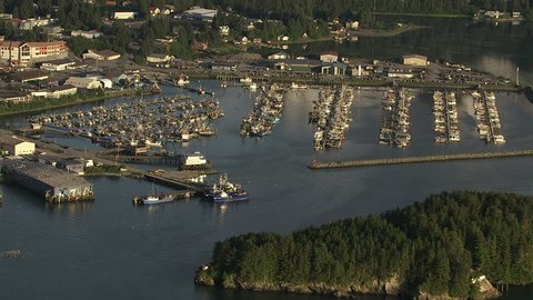 Approaching and rotating over fishing boats in harbor at Cordova, Alaska. Shot in July 2012.