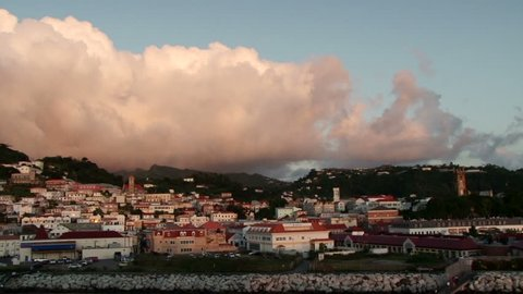 View of white dramatic clouds behind St George's town in Grenada, taken at sunset