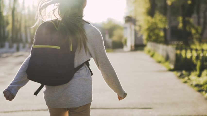 Child is running with a school bag in sunny day. Steadicam shot. Slow motion 100 fps | Shutterstock HD Video #26967244