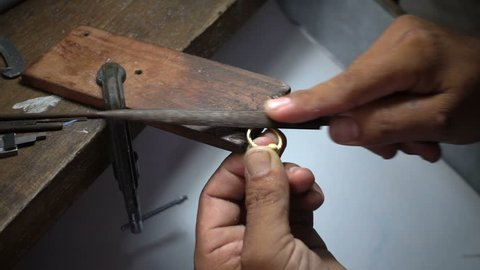 Slow motion video,Goldsmith is polishing a gold or silver ring