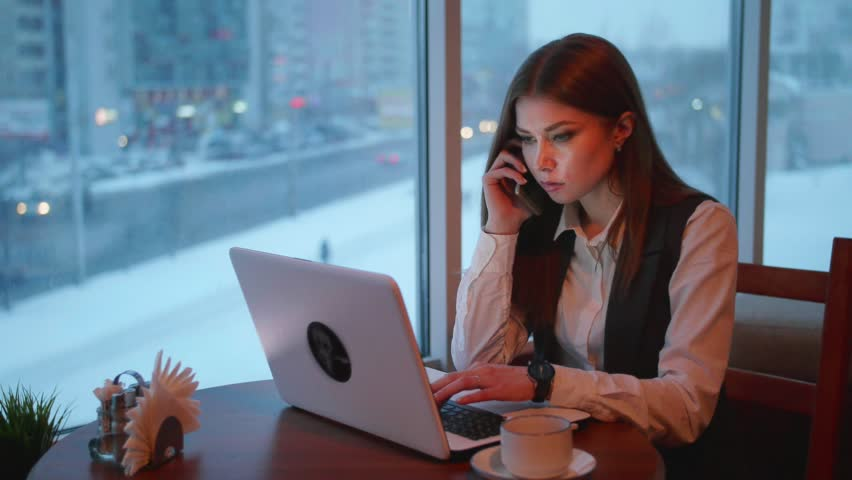 One busines women working with laptop in cafe | Shutterstock HD Video #26976856