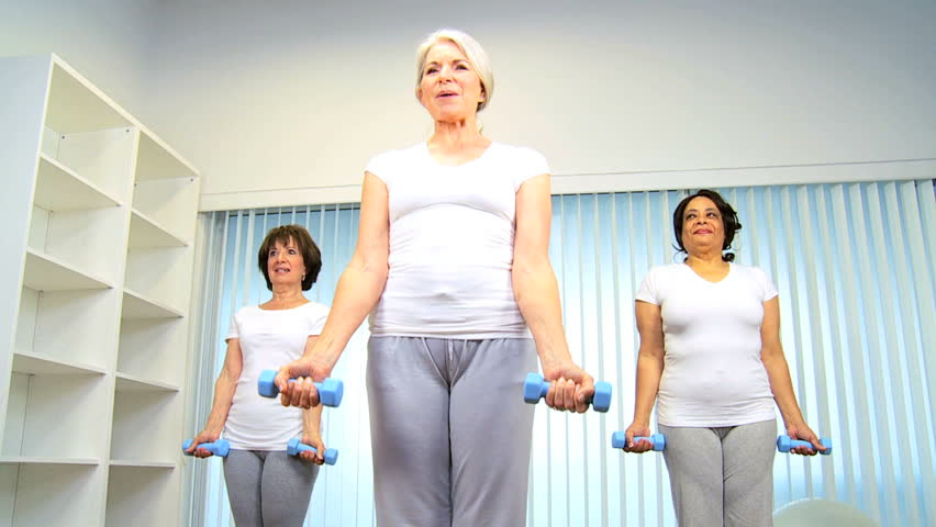 Mature Group Retired Females Using Weights Exercise Health Club Stock Footage Video -1146